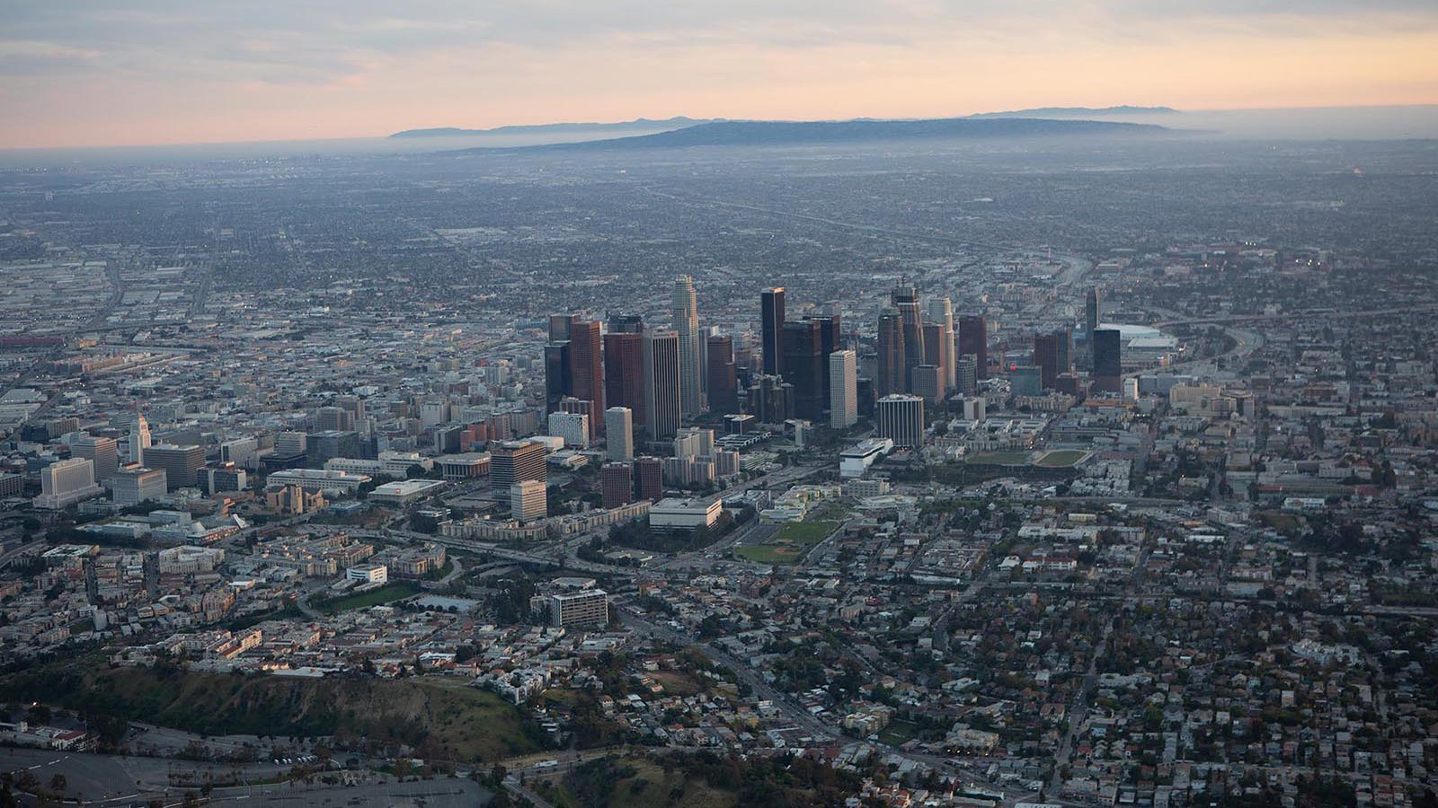Aerial cityscape of Downtown Los Angeles Skyline at Sunset before any post-production or color-correction