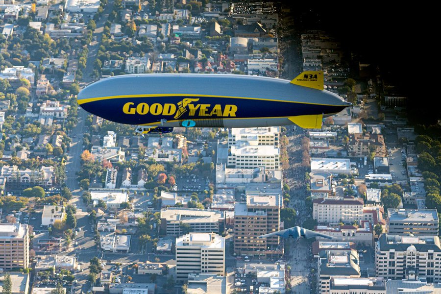 Blog photo of the B-2 Stealth Bomber flying under the Goodyear Blimp in Pasadena, California