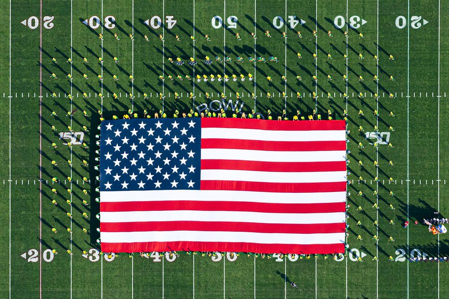 Blog image of the Oregon Marching Band (OMB) holding an American Flag on the field of the 106th Rose Bowl Game