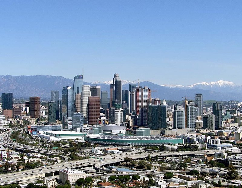 HD Aerial Helicopter Still Image of Downtown Los Angeles, California with Snow in the Mountains