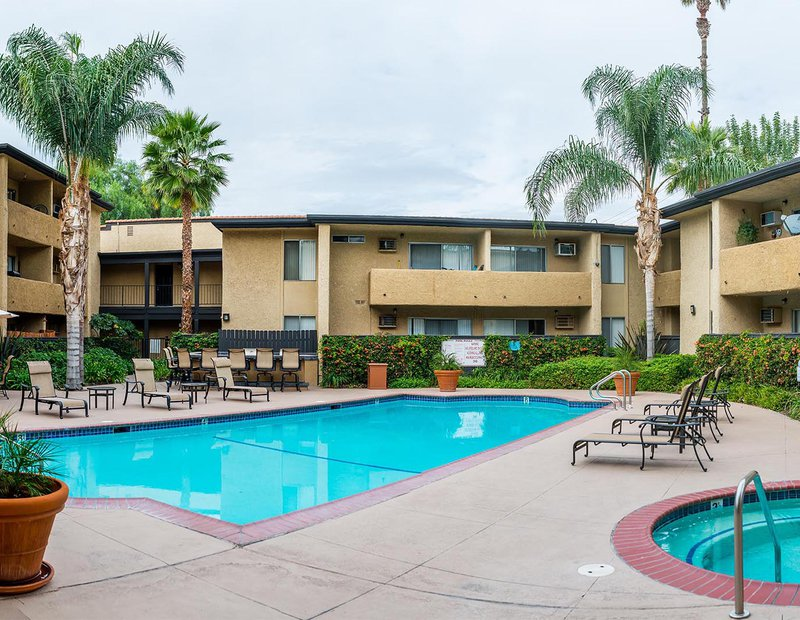Exterior architectural image of the pool and common areas of an apartment complex in Canoga Park, California