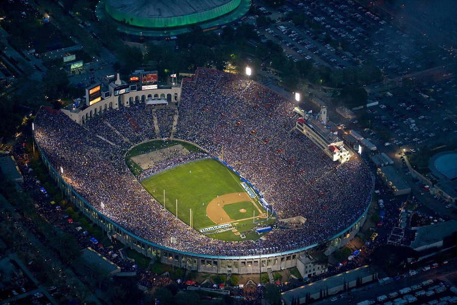 Sports photograph of the LA Memorial Coliseum during the 50th Anniversary baseball match between the Boston Red Sox and the Los Angeles Dodgers