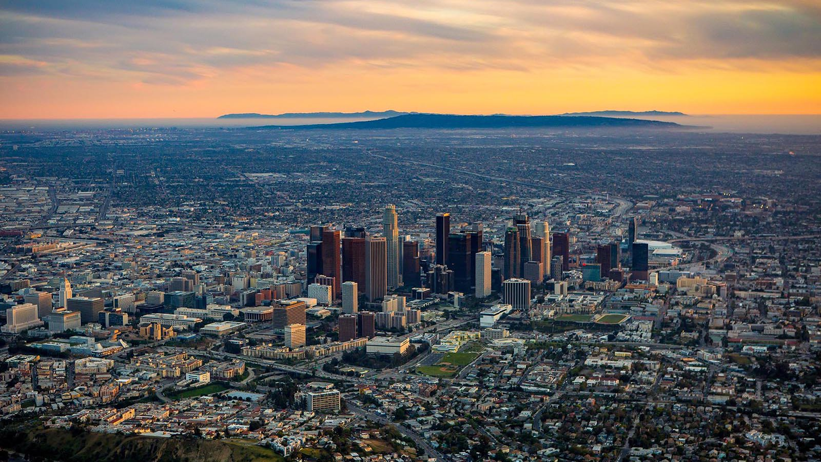Aerial cityscape of Downtown Los Angeles Skyline at Sunset with Santa Catalina Island in the background