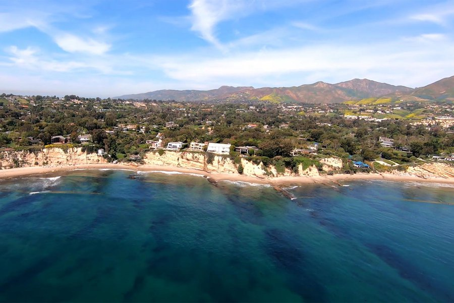 HD Aerial Video Frame of the Ocean Front Homes in Malibu, California with the California Poppies Visible in the Mountains