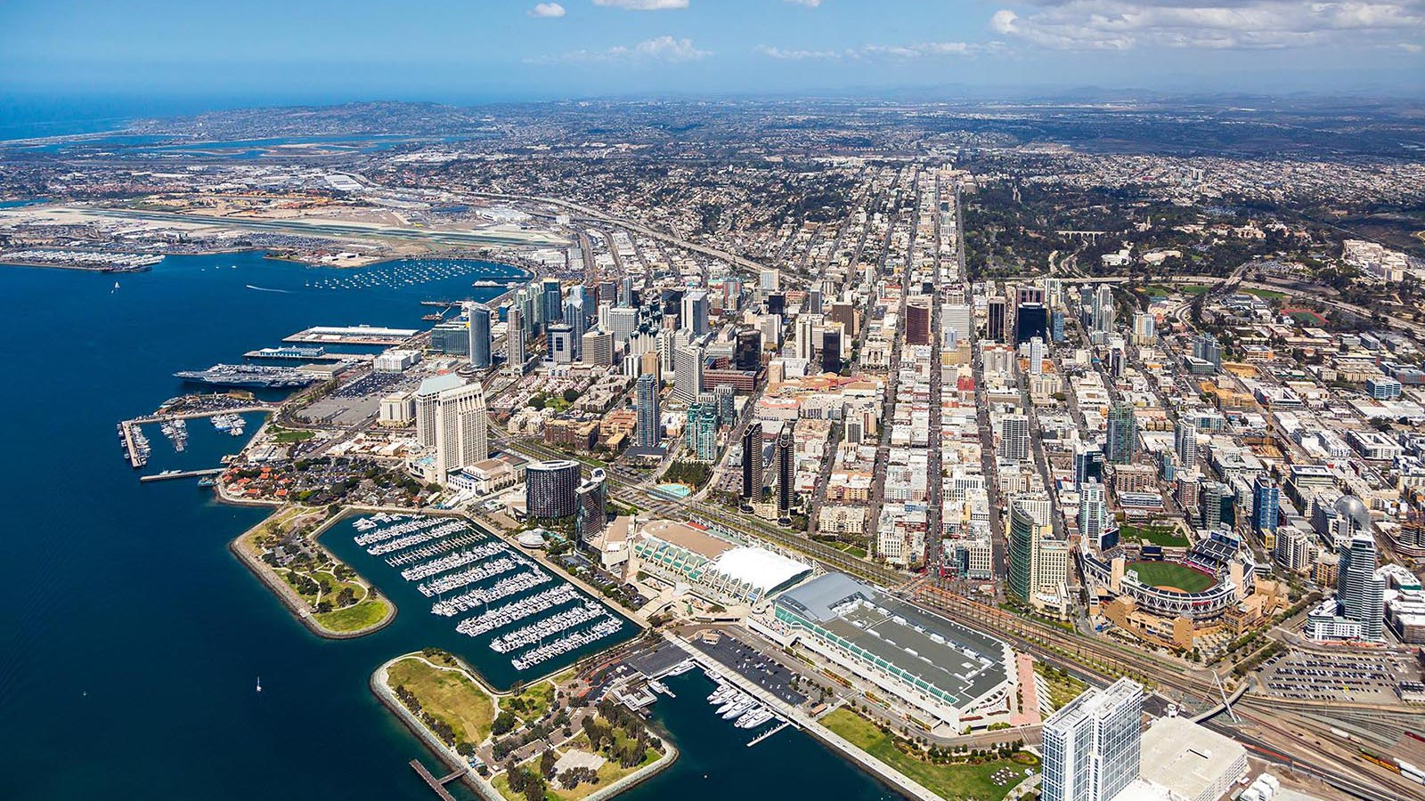 Aerial cityscape of the Downtown San Diego Skyline with the San Diego Convention Center and Petco Park in the foreground