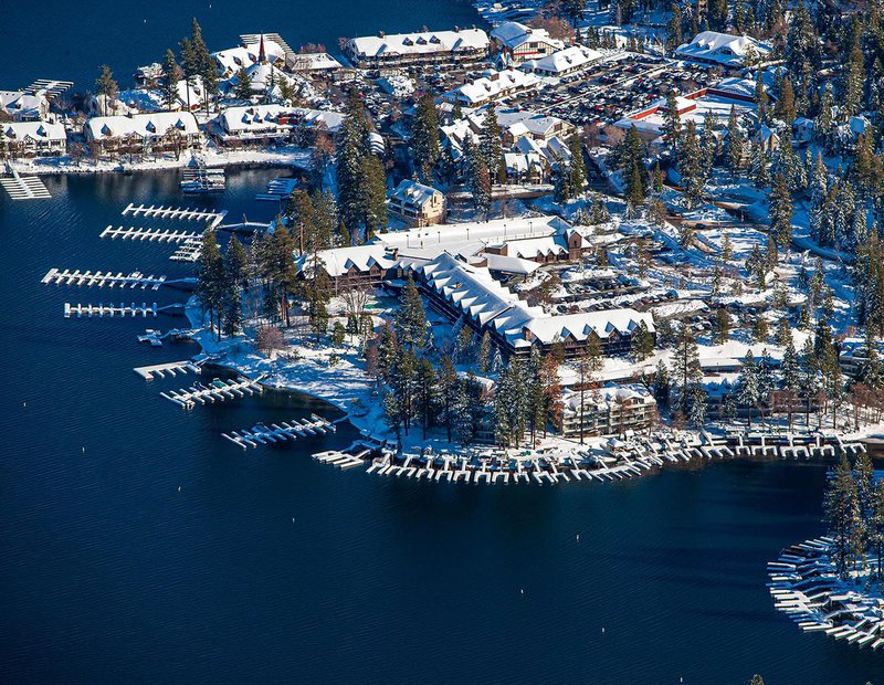 Commercial real estate image of the  Lake Arrowhead Resort & Spa covered in snow in the winter