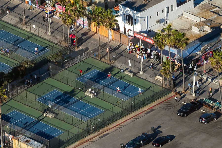 Blog photograph of paddle tennis players during a match at the paddle tennis courts in Venice Beach, California on Christmas Day, 2020.