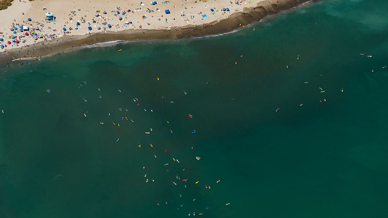 Blog image of beach goers and surfers in Dana Point, California on a hot summer day