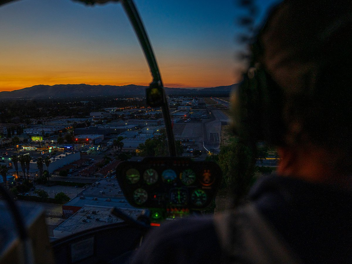Blog image of cockpit view over Van Nuys, California, during sunset helicopter flight