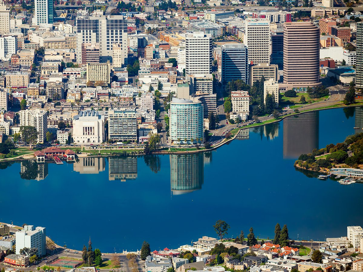 Blog photo of Lake Merrit in Oakland, California, with reflections of the buildings reflecting off the surface of the lake